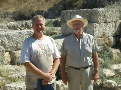 Dr William Dever director of the 1971 excavation at Tel Gezer poses with Solomonic Gate